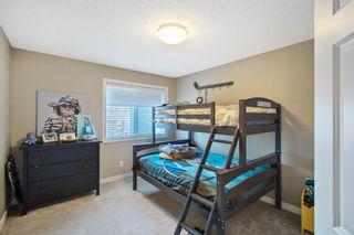 Photo 25: 64 Ridge View Close: Cochrane Detached for sale : MLS®# A1087385
