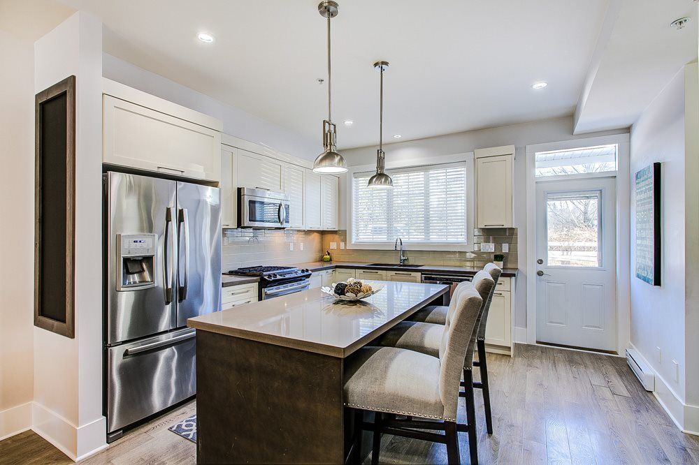"""Main Photo: 4 12161 237 Street in Maple Ridge: East Central Townhouse for sale in """"VILLAGE GREEN"""" : MLS®# R2358297"""
