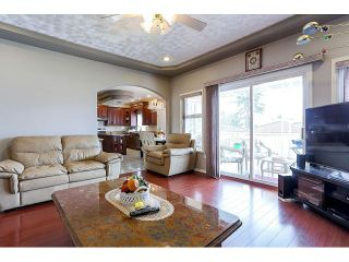Photo 9: 7571 DAVIES ST - LISTED BY SUTTON CENTRE REALTY in Burnaby: Edmonds BE House for sale (Burnaby East)  : MLS®# V1113465