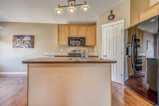 Photo 9: 411 EVERMEADOW Road SW in Calgary: Evergreen Detached for sale : MLS®# A1025224