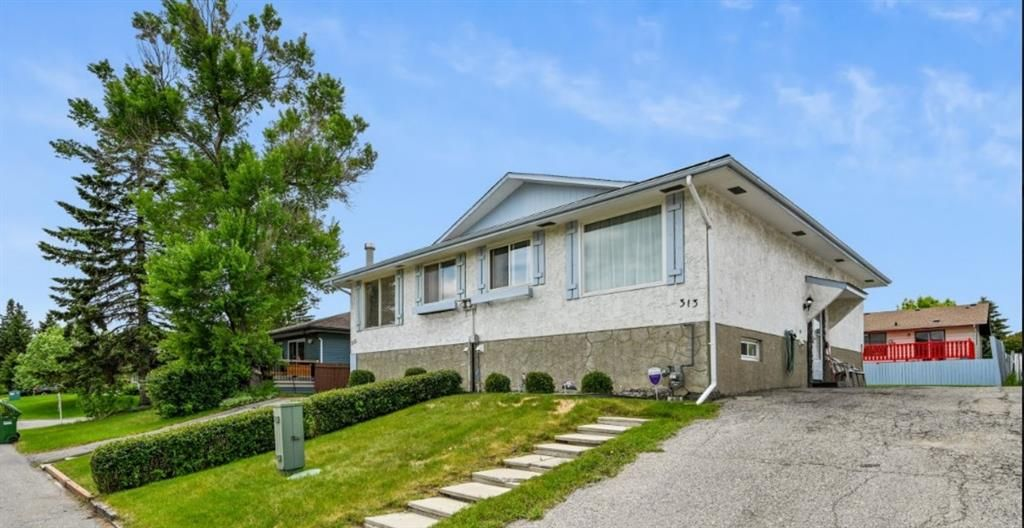 Main Photo: 313 42 Street SE in Calgary: Forest Heights Semi Detached for sale : MLS®# A1118275