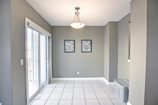 Photo 9: 108 Cedarwood Lane SW in Calgary: Cedarbrae Row/Townhouse for sale : MLS®# A1095683