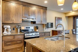 Photo 7: 123 Tremblant Way SW in Calgary: Springbank Hill Detached for sale : MLS®# A1022174