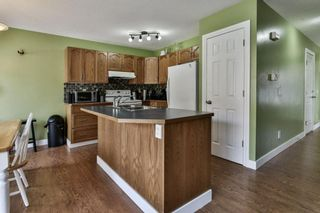 Photo 6: 93 Rocky Vista Circle NW in Calgary: Rocky Ridge Row/Townhouse for sale : MLS®# A1071802