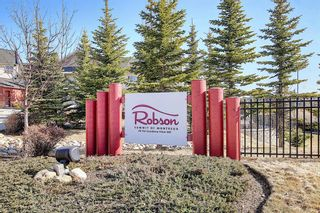 Photo 2: 213 26 VAL GARDENA View SW in Calgary: Springbank Hill Apartment for sale : MLS®# A1095989