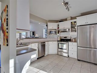 Photo 2: 203 438 31 Avenue NW in Calgary: Mount Pleasant House for sale : MLS®# C4119240