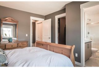 Photo 12: 95 West Coach Manor SW in Calgary: West Springs Row/Townhouse for sale : MLS®# A1114599