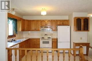 Photo 4: 11 Erminedale Bay N in Lethbridge: House for sale : MLS®# A1093060