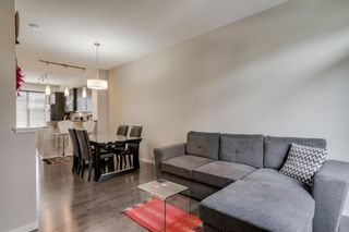 Photo 21: 235 ASCOT Circle SW in Calgary: Aspen Woods Row/Townhouse for sale : MLS®# A1025064