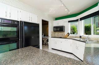 "Photo 15: 11648 HYLAND Drive in Delta: Sunshine Hills Woods House for sale in ""SUNSHINE HILLS"" (N. Delta)  : MLS®# F1417122"