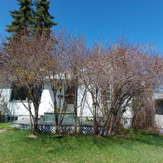 Photo 8: 208 25 Avenue NW in Calgary: Tuxedo Park Detached for sale : MLS®# A1109100