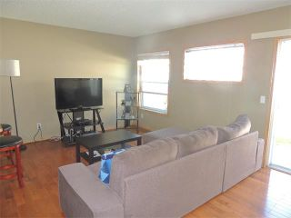 Photo 5: 37 MILLVIEW Green SW in Calgary: Millrise House for sale : MLS®# C4015611