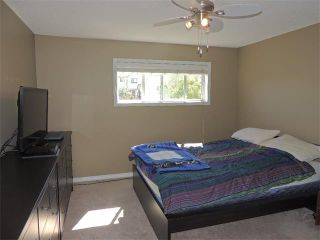 Photo 12: 37 MILLVIEW Green SW in Calgary: Millrise House for sale : MLS®# C4015611
