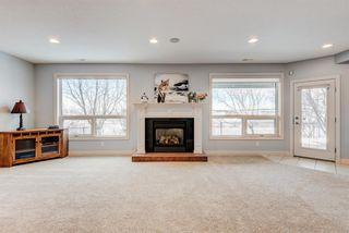 Photo 32: 227 Sunterra Ridge Place: Cochrane Detached for sale : MLS®# A1058667