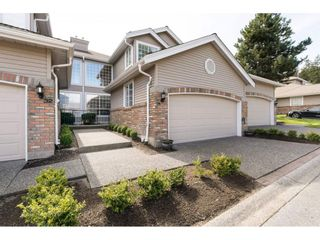 """Photo 1: 31 2688 150 Street in Surrey: Sunnyside Park Surrey Townhouse for sale in """"Westmoor"""" (South Surrey White Rock)  : MLS®# R2256437"""