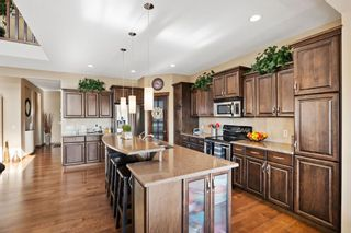 Photo 15: 124 Tremblant Way SW in Calgary: Springbank Hill Detached for sale : MLS®# A1088051