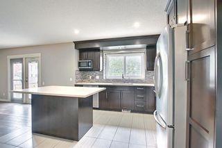 Photo 12: 23 Castlefall Way NE in Calgary: Castleridge Detached for sale : MLS®# A1141276