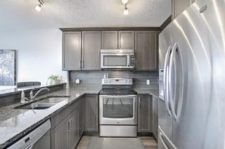 Photo 11: 731 101 Sunset Drive: Cochrane Row/Townhouse for sale : MLS®# A1077505