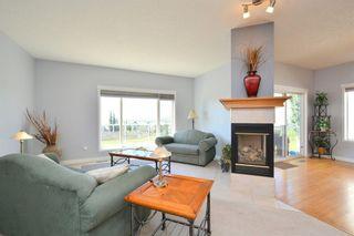 Photo 24: 303 GLENEAGLES View: Cochrane House for sale : MLS®# C4130061