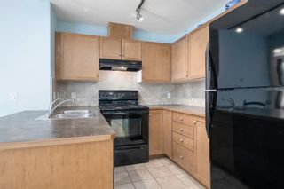Photo 10: 3215 92 Crystal Shores Road: Okotoks Apartment for sale : MLS®# A1103721