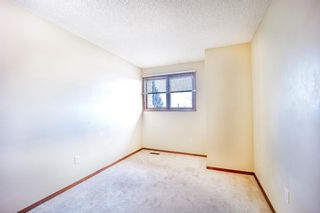 Photo 21: 7050 Edgemont Drive NW in Calgary: Edgemont Row/Townhouse for sale : MLS®# A1108400