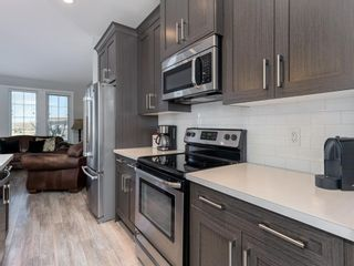 Photo 7: 193 River Heights Drive: Cochrane Row/Townhouse for sale : MLS®# A1083109