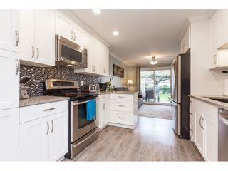 """Photo 9: 136 5641 201 Street in Langley: Langley City Townhouse for sale in """"The Huntington"""" : MLS®# R2409027"""