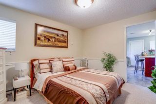 Photo 12: 8736 TULSY Crescent in Surrey: Queen Mary Park Surrey House for sale : MLS®# R2192315
