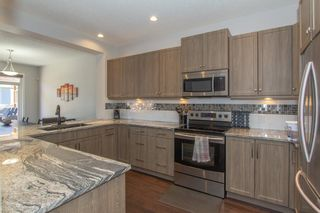 Photo 12: 124 Kingsmere Cove SE: Airdrie Detached for sale : MLS®# A1115152