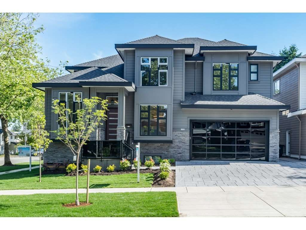 Main Photo: 12988 CARLUKE Crescent in Surrey: Queen Mary Park Surrey House for sale : MLS®# R2415665