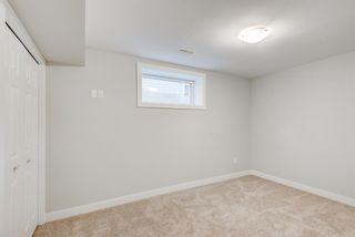 Photo 17: 572 Cougar Ridge Drive SW in Calgary: Cougar Ridge Detached for sale : MLS®# A1143842