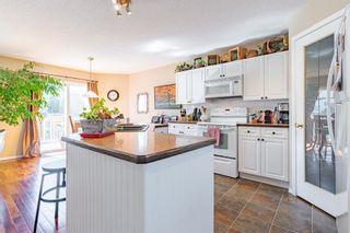 Photo 28: 21 Bow Ridge Crescent: Cochrane Detached for sale : MLS®# A1079980