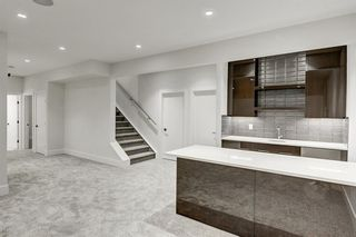Photo 15: 5911 Lockinvar Road SW in Calgary: Lakeview Detached for sale : MLS®# A1048910