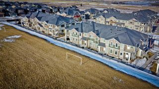 Photo 1: 109 250 Sage Valley Road NW in Calgary: Sage Hill Row/Townhouse for sale : MLS®# A1061323