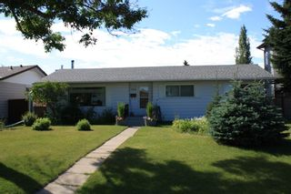 Photo 1: 159 Rosery Drive NW in Calgary: Rosemont Detached for sale : MLS®# A1040112