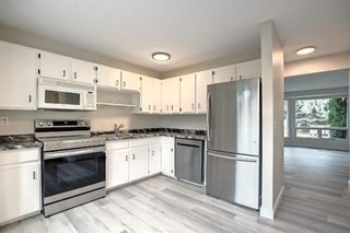 Photo 7: 77 123 Queensland Drive SE in Calgary: Queensland Row/Townhouse for sale : MLS®# A1145434