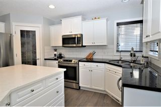 Photo 4: 7476 Springbank Way SW in Calgary: Springbank Hill Detached for sale : MLS®# A1071854