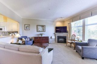 "Photo 3: 404 15323 17A Avenue in Surrey: King George Corridor Condo for sale in ""SEMIAHMOO PLACE"" (South Surrey White Rock)  : MLS®# R2308322"