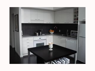 """Photo 1: 103 REGIMENT Square in Vancouver: Downtown VW Townhouse  in """"SPECTRUM 3"""" (Vancouver West)  : MLS®# V817637"""