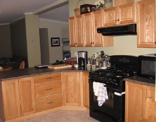 """Photo 4: Photos: 11 ROCKY MOUNTAIN Road in Fort_Nelson: Fort Nelson - Rural Manufactured Home for sale in """"SATENEH ESTATES"""" (Fort Nelson (Zone 64))  : MLS®# N179978"""
