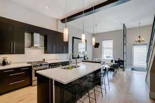 Photo 12: 100 18 Avenue SE in Calgary: Mission Row/Townhouse for sale : MLS®# A1100251