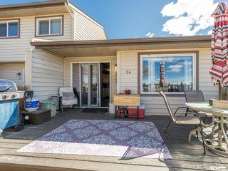 Photo 4: 24 6100 4 Avenue NE in Calgary: Marlborough Park Semi Detached for sale : MLS®# A1102275