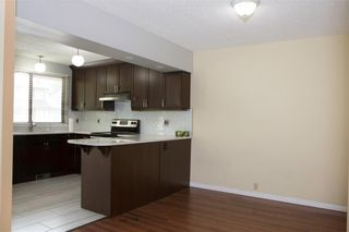 Photo 8: 1 10 POINT Drive NW in Calgary: Point McKay Row/Townhouse for sale : MLS®# A1089848