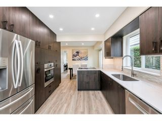 """Photo 1: 9518 WILLOWLEAF Place in Burnaby: Forest Hills BN Townhouse for sale in """"Willowleaf Place"""" (Burnaby North)  : MLS®# R2561728"""