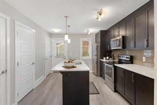 Photo 8: 1011 2400 Ravenswood View SE: Airdrie Row/Townhouse for sale : MLS®# A1121287