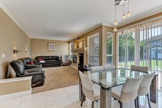 """Photo 17: 7439 146 Street in Surrey: East Newton House for sale in """"Chimney Heights"""" : MLS®# R2602834"""