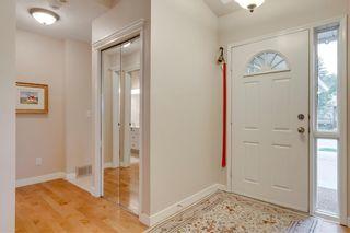 Photo 2: 66 GLENMORE Green SW in Calgary: Kelvin Grove Semi Detached for sale : MLS®# A1029652