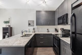 Photo 6: 205 Jumping Pound Common: Cochrane Row/Townhouse for sale : MLS®# A1138561