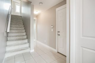 Photo 2: 1102 5305 32 Avenue SW in Calgary: Glenbrook Row/Townhouse for sale : MLS®# A1126804
