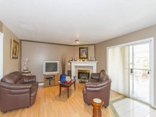 """Photo 6: 7952 144 Street in Surrey: Bear Creek Green Timbers House for sale in """"BRITISH MANOR"""" : MLS®# R2049712"""